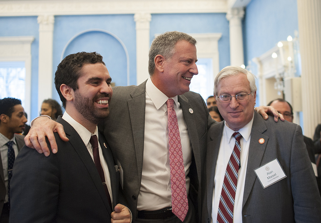 Councilmembers Rafael Espinal and Alan Maisel, seen embracing Mayor de Blasio, are among two former state legislators who left Brooklyn seats vacant when they won municipal office last fall. A fifth seat was made vacant by a corruption conviction.