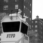 Under Commissioner Ray Kelly, the NYPD has drastically increased its surveillance capabilities, from stationing sky towers like the one above in high crime neighborhoods, to the Ring of Steel in Lower and Midtown Manhattan.