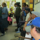 Residents wait early morning in the lobby of the Washington Heights and Inwood Coalition for the housing assistance officer to start work.