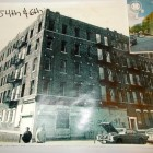 At its offices, Neighbors Helping Neighbors (NHN) displays large posters showing the graffiti, broken windows, and other building dilapidation that characterized many blocks in Sunset Park before federal funds helped rehabilitate damaged buildings.