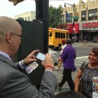 State Senator Gustavo Rivera, left, was doing everything he could to help Quinn's campaign in the Bronx. Frequently he would start a sentence in English and end it in Spanish, as he sought to rally the support of spanish speaking voters. Here he plays photographer for the greatful Miriam Torres.
