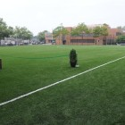 The field outside the rec center already has fences. The question is whether they are high enough--not just to protect passing cars, but also to permit older kids to use the field.