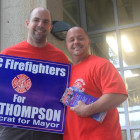 Eric Dio, 37 (right) and Mike Degan, 33, from FDNY's 7th Ladder and 20th Battalion, support Bill Thompson at the Parkchester MTA station.