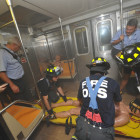 The author (left) and teammates Peter Haskell of CBS News Radio (center) and Mark McMillan from the Queens Borough President's office, rescue a victim of a subway bombing during a Fire Ops 101 drill.