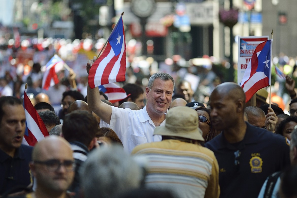 Mayor Bill de Blasio marches in the Puerto Rican Day Parade on Fifth Avenue in June.