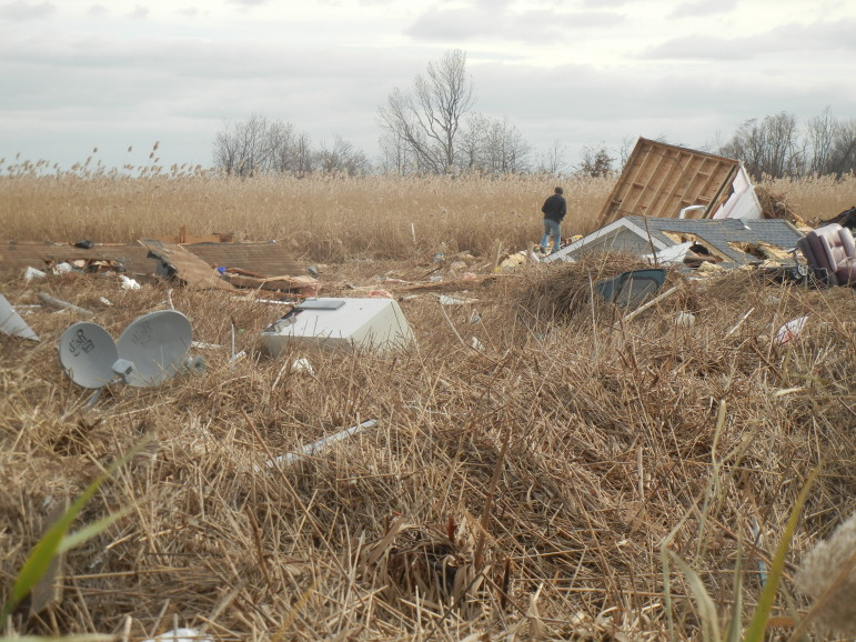 This marsh in the Oakwood Beach area of Staten Island became the final resting place for roofs, appliances and clothes.