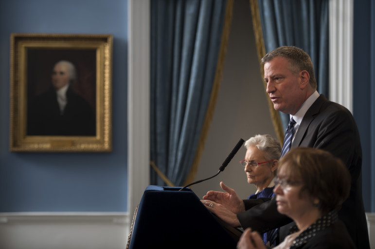 Just 17 days into his term, Mayor de Blasio (flanked by ACS Commissioner Carríon and Deputy Mayor Barrios-Paoli) discussed preliminary findings on the death of Myls Dobson, whose family had been investigated by city child-welfare officials.