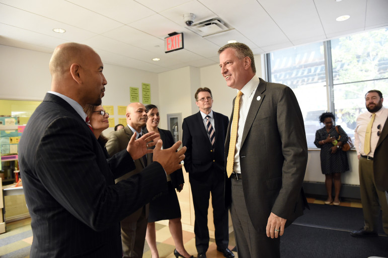 Bronx Borough President Ruben Diaz Jr. talks with Mayor de Blasio in this file photo. According to Diaz, there's disagreement about what shape the mayor's housing plan should take in the Bronx—and Diaz's view is the right one.