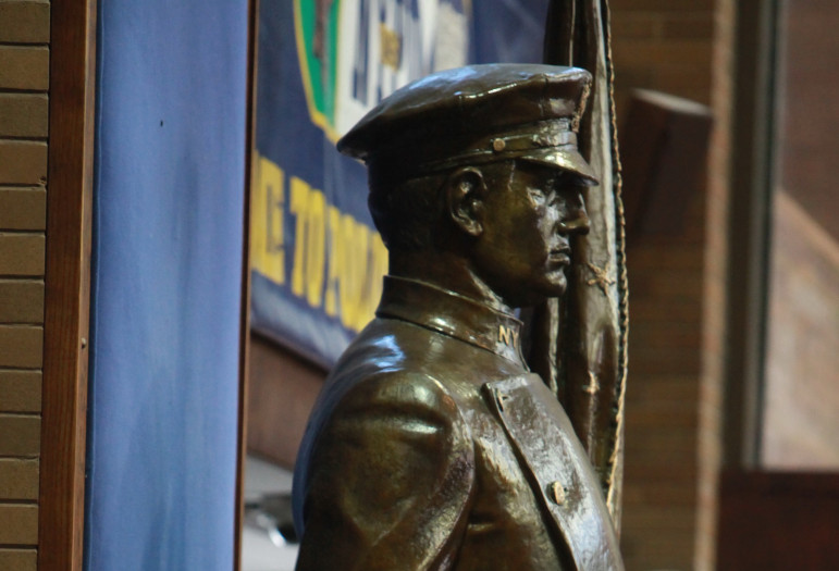 A statue inside One Police Plaza memorializes the NYPD's duty to defend the defenseless. But performing that duty is complex in sex trafficking cases.