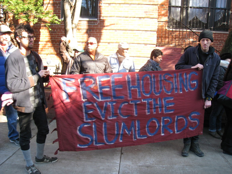 A protest outside landlord Joel Israel's apartment in 2014.