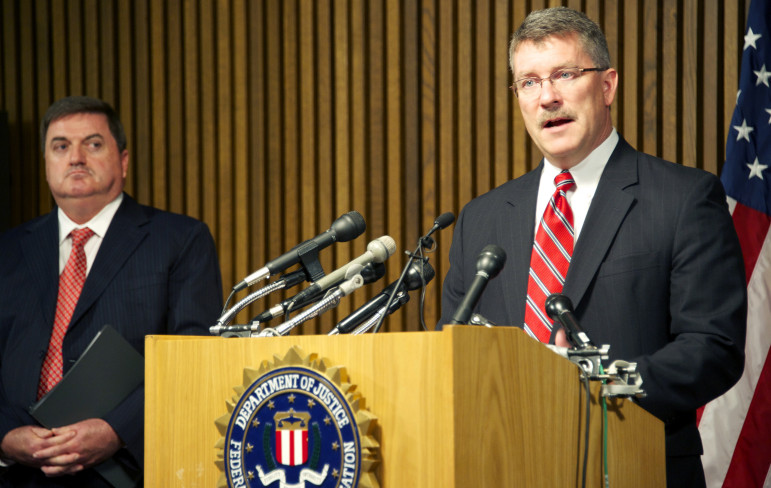 FBI official Ron Hasko and John Ryan, CEO of the National Center for Missing and Exploited Children, announce the 76-city sweep in 2013 that rescued 105 children who were victims of sex trafficking, most of whom had been in foster care.
