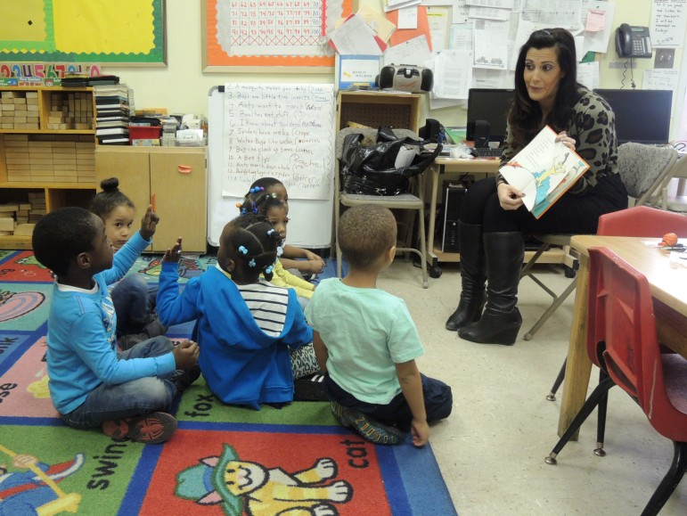"""BCS volunteer participating in, """"Read by Example,"""" a service project for Spring into Action-2014."""