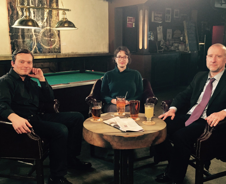 Straight Up guests Dana Rubinstein (center) and Chris Smith (right) look like they're having a blast with host Jarrett Murphy on the set of Straight Up at the Emerson Bar in Clinton Hill.