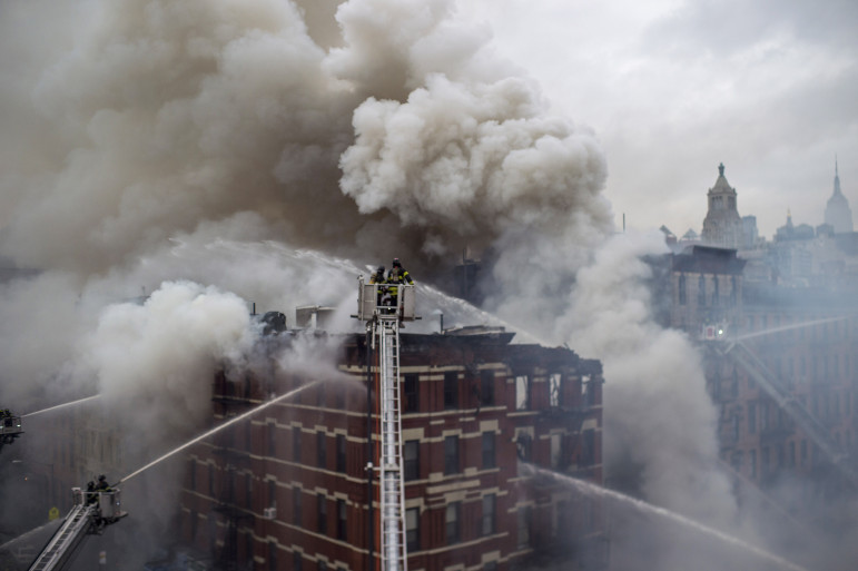 Firefighters battle flames after the March 26 explosion in the East Village, which killed two, injured 19 and destroyed three buildings.