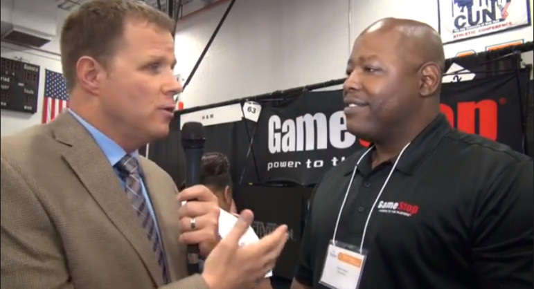 Victor Neain of GameStop (right) tells City Limits' Marc Bussanich that he hasn't time at a job fair to pore over an applicant's work history. Rather, he is looking for people with the right attitude with whom he will follow up after the event.