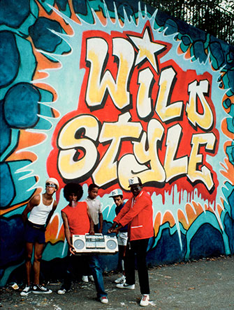 07-30-Charlie-Ahearn-Wild-Style-Wild-Style-mural-with-Fab5Freddy-and-Rock-Steady-mural-by-Zephyr-Revolt-and-Sharp-1983-photo-by-Martha-Cooper_335W