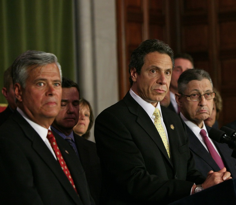 Gov. Cuomo seen in a 2011 photo with the two legislative leaders arrested on corruption charges this year, Dean Skelos at left and Sheldon Silver. Those arrests help set the stage for this week's last-minute drama.