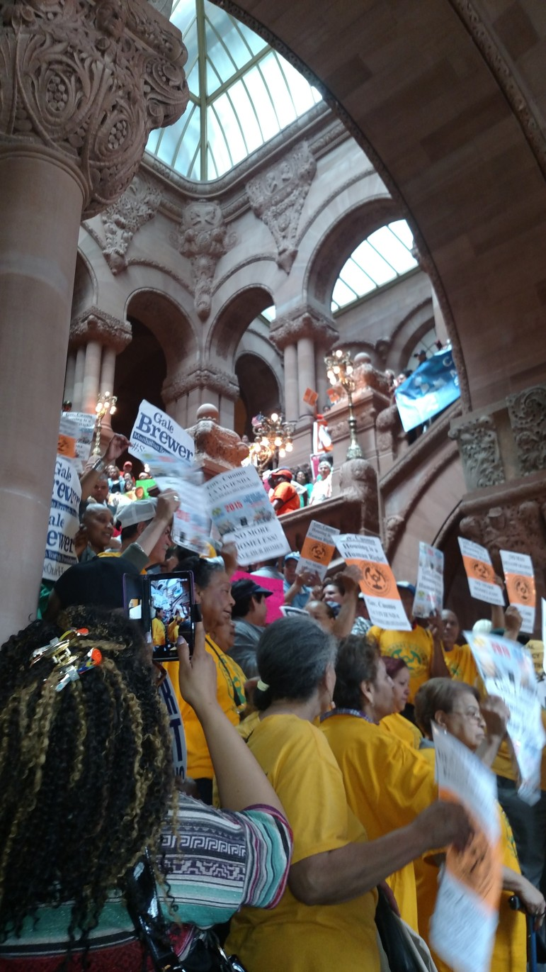 Tenants crowd the capitol stairs.