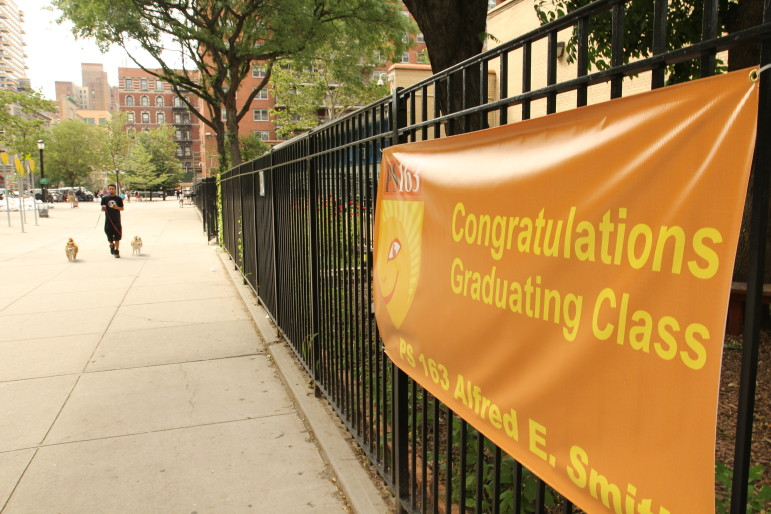 A banner welcomes the end of the school year at P.S. 163 on Manhattan's Upper West Side. Though most classes are done there and at other DOE facilities, the issues facing New York's educators, parents and students do not take a summer break.