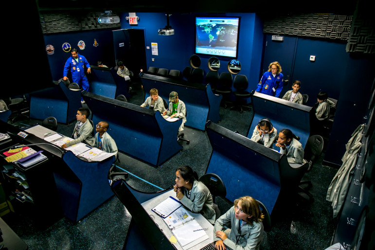 Students monitor a trip to the International Space Station from Mission Control at the Department of Education's Summer Space Camp at the New York City Center for Space Science Education.