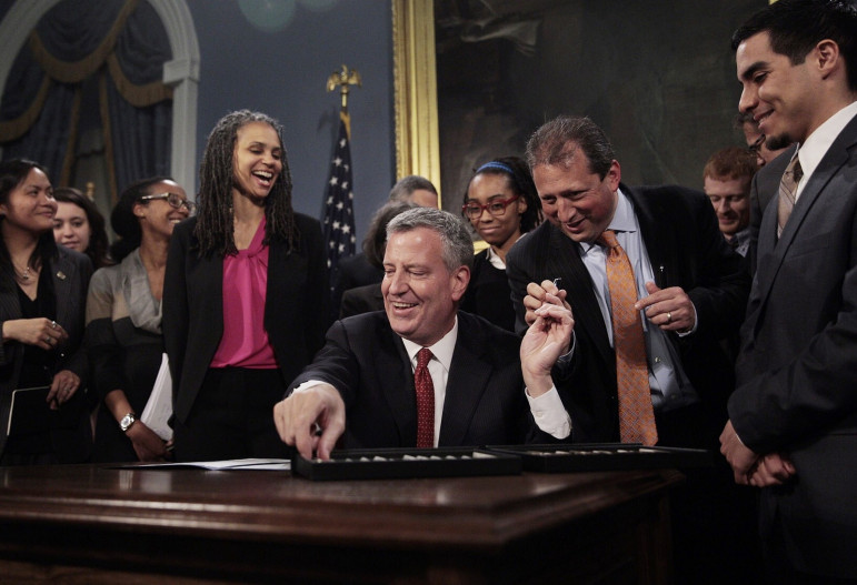 Mayor de Blasio signed the credit-check ban in May.