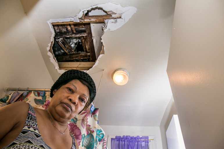Marie Larochel in her apartment at 538 East 21st Street in Brooklyn, which she shares with her pregnant daughter. About a month ago, a water leak caused a hole in her bathroom ceiling.