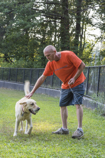 Walking the dog in Van Cortland Park.