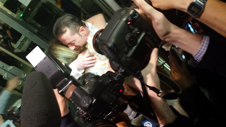 Johnny Hincapie embraces his mother as he leaves the courthouse after getting his conviction overturned on October 6.