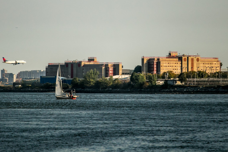 George R. Vierno Center on Rikers Island, seen from the Bronx. Deep concern about problems on the island is interwoven with a broader critique of the criminal-justice system.