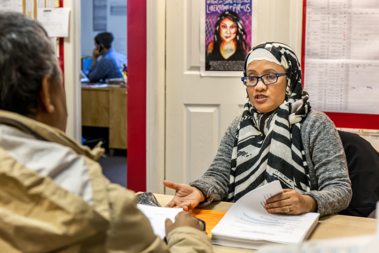 Kazi Fauzia in her office at Desis Rising Up and Moving in Queens, speaking with a client seeking legal services. A DRUM report revealed that more than half of all retail workers whom they surveyed make less than the minimum wage.