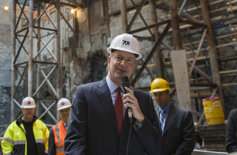 Mayor Bill de Blasio seen in late October delivering remarks at the groundbreaking ceremony for a mixed-use development at 20 Times Square.  Since his mayoral campaign, mandatory inclusionary zoning has been a key piece of his housing agenda.