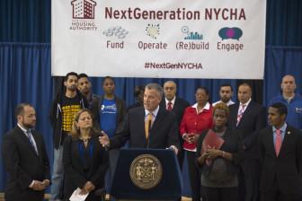 Olatoye flanks Mayor de Blasio at the rollout of NextGeneration NYCHA in May.