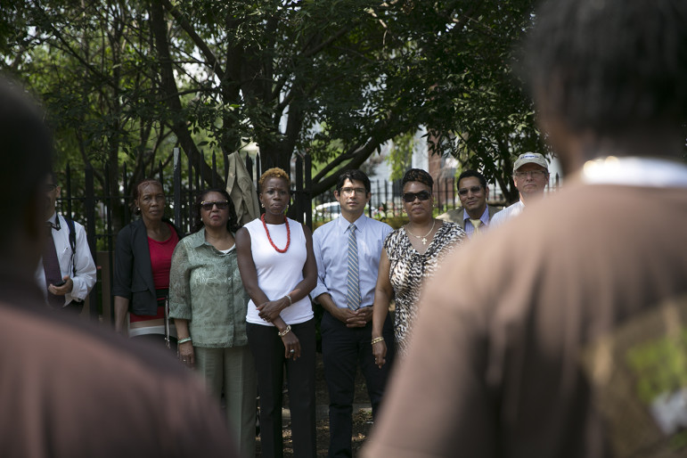 NYCHA chairwoman Shola Olatoye, in white shirt, at a 2014 outreach event in Brooklyn. Her fans credit her with being more accessible, but there have been limits on public engagement's impact on NYCHA policy.