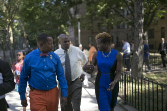 Bronx Councilmember Andrew King tours a NYCHA development with authority chairwoman Shola Olatoye.