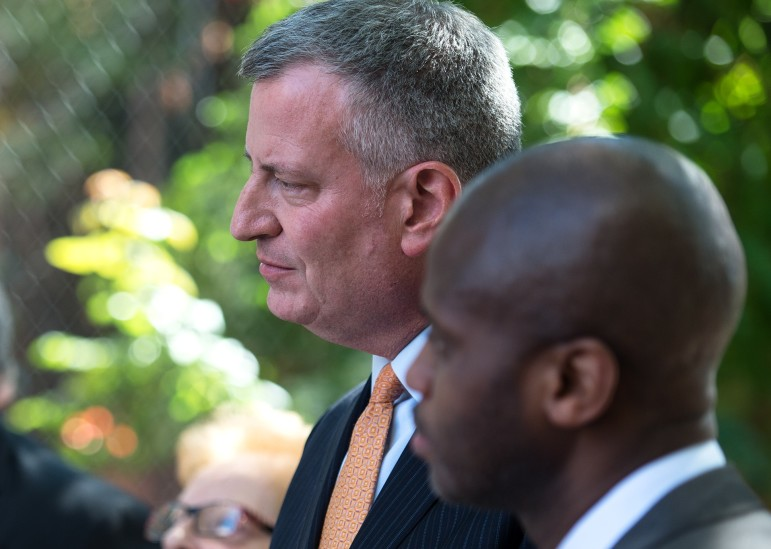 The mayor with outgoing DHS head Gilbert Taylor at an event in September.