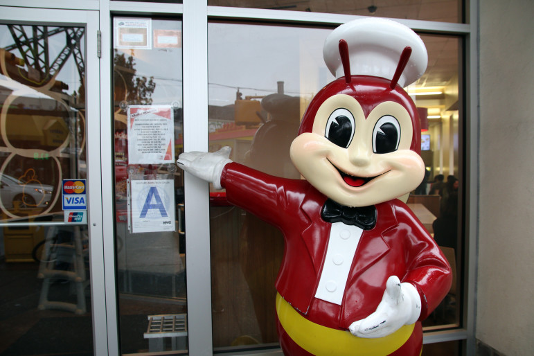 The Jollibee mascot in front of the company's only New York City location in Woodside, Queens.