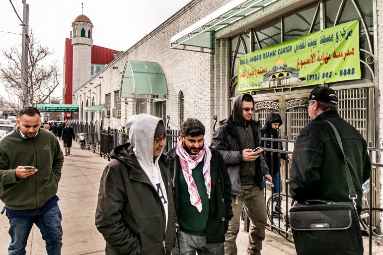 On a recent Friday, men leave the Beit El-Maqdis Islamic Center. The Center is in Sunset Park, just north of Bay Ridge, a neighborhood with a heavy Arab presence where Syrians might be relocated if they came to New York City in any numbers.