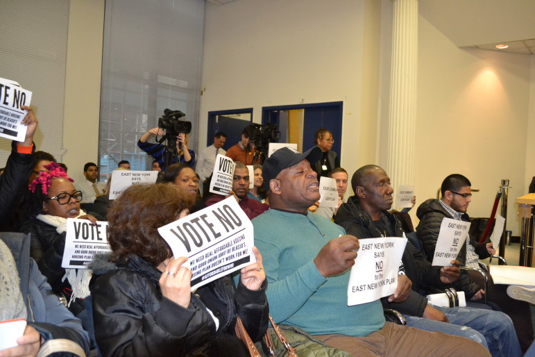 Protesters at the hearing. The de Blasio administration says it will work to ensure that half the new housing created in East New York is affordable.
