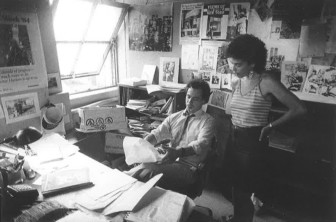 Tom Robbins and Annette Fuentes, City Limits' editing team in the early 1980s, in the magazine's offices.