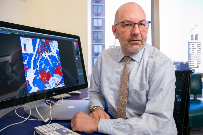 Attorney Craig Gurian at his office in Manhattan. His computer shows a map of racial concentration in New York City neighborhoods.