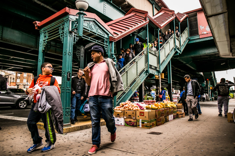Passengers exit the 1 train at 207th Street and 10th Avenue.