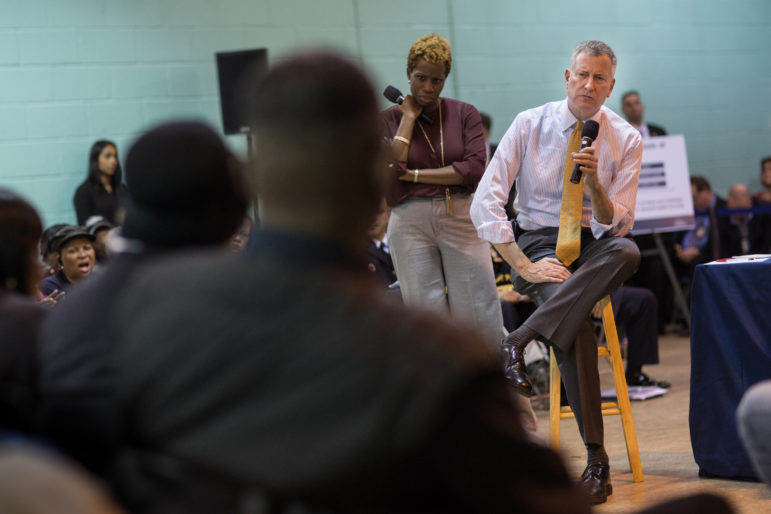 Mayor Bill de Blasio and NYCHA Chair Shola Olatoye seen in January at a forum at the Wycoff Houses in Brooklyn. The authority says the private-sector partnerships it has embraced under Olatoye shore up finances and improve services to residents.