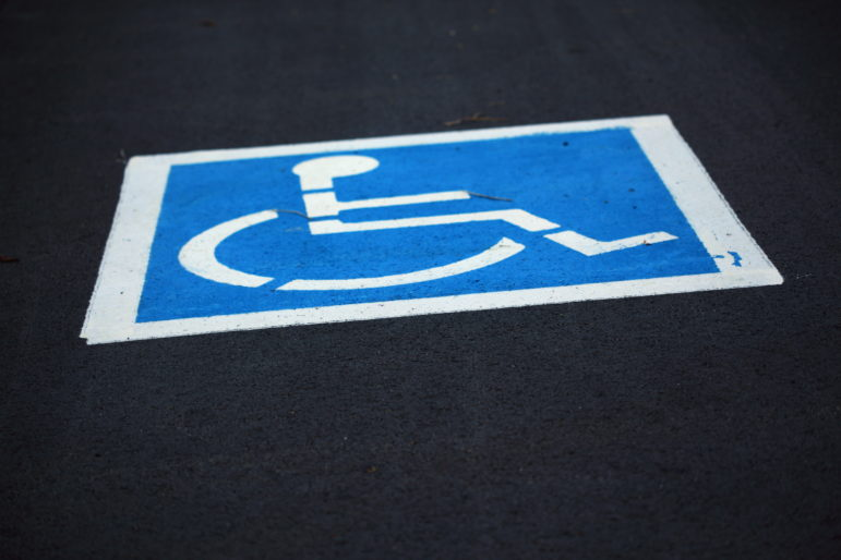 Free_Freshly_Painted_Handicap_Wheelchair_Parking_Sign_in_Parking_Lot_Creative_Commons_(5657947214)