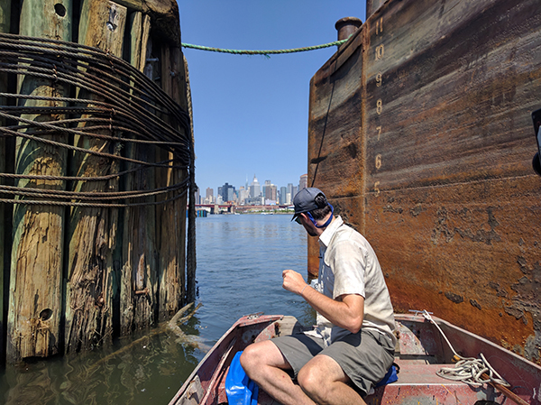 Willis Elkins of the Newtown Creek Alliance at a point in the creek where its industrial feel gives way to a distant view of Manhattan.