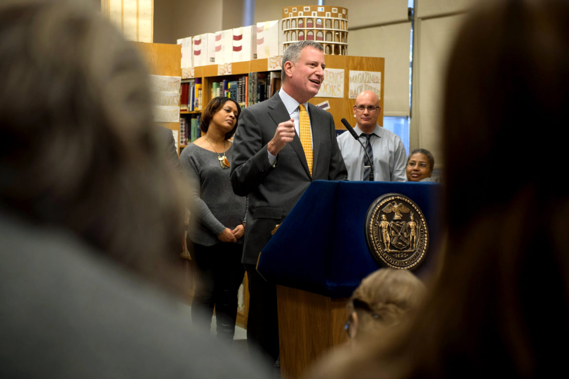The mayor visiting a school in 2015.