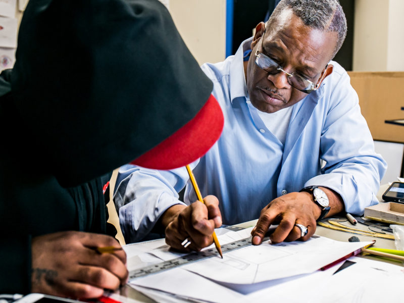 On a recent Thursday, Guy Woodard teaching a client single perspective drawing during an art class at the Fortune Society's Long Island City location. Woodard got out of prison in July 2015. He began teaching art a month later.