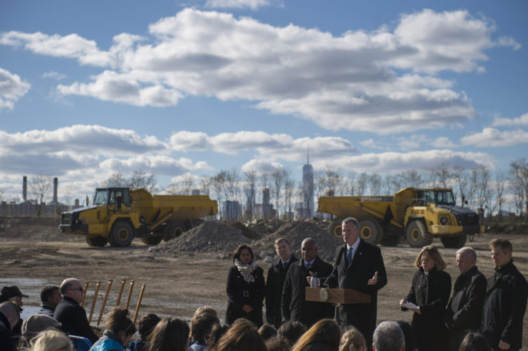 Mayor de Blasio breaks ground on Phase II of Hunter's Point South in November 2015. His administration has faced pressure from some quarters to increase the community set-aside in such projects even as it fights a lawsuit seeking to eliminate those preferences altogether.
