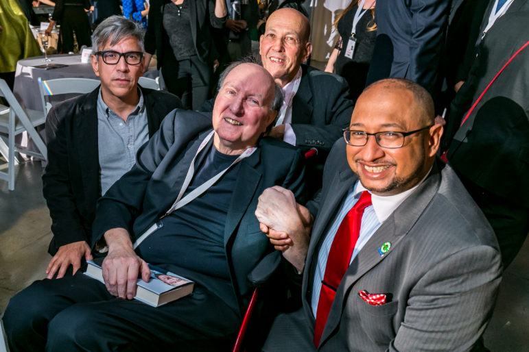 Honorees Barrett and Garrido (at right) joined by Eddie Borges (in glasses) and Fred Smith.