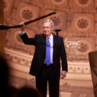 Mitch McConnell, who here appears to be surrendering his musket to an unruly crowd at the CPAC convention, is now the Senate majority leader. November 8 will determine whether he has to surrender that title to.