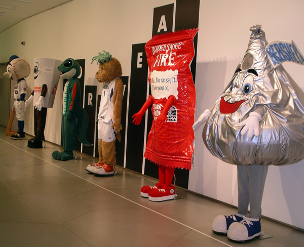 Costumes of mascots show just how much a worker's identity can be subsumed by clothing for the job.